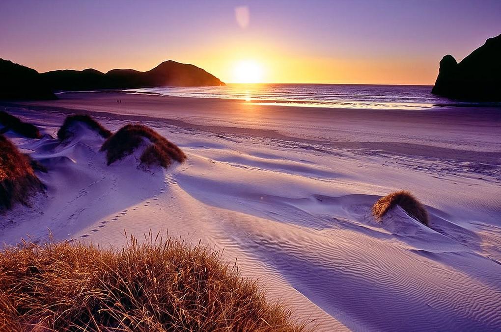 wharariki-beach-atardecer-nueva-zelanda-comoserunkiwi